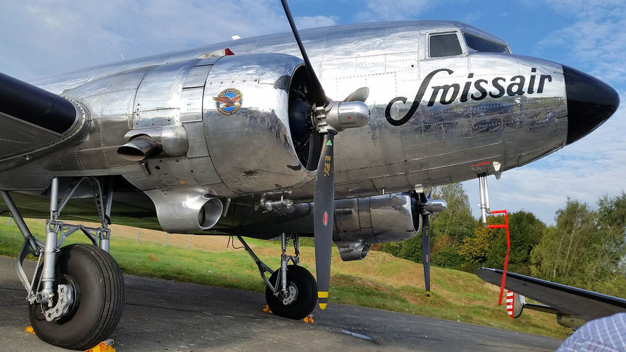 Aircraft Dakota  DC-3 Swissair Twin Engine Propeller Propeller Airplane Shiny Polished Metal Aluminum Vintage Day Sky