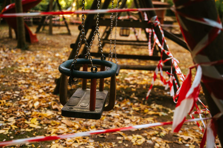 Close-up of empty swing in park during autumn