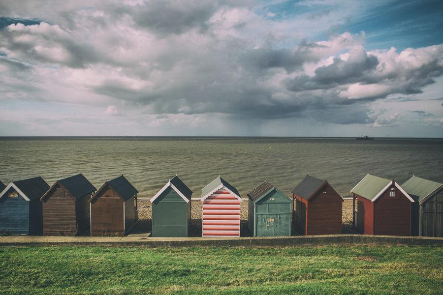 Beach Huts, Kent, England Beach Beach Huts England In A Row Kent Moody Sky Rain Sea Sky Tranquility Uk
