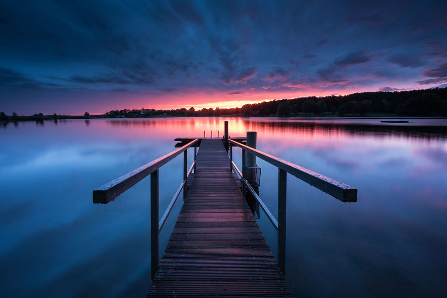 Reflection Lake Pier Beauty In Nature Outdoors Landscape Water Scenics Nature Sky Sunset Sundown Cloud - Sky Water Reflections