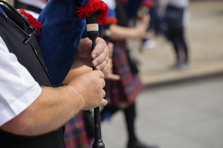 Man playing bagpipe, scottish traditional pipe band Asturias City Holiday Horizontal Man Music SPAIN Scottish Close Up Day Folk Folklore Holding Human Body Part Kilt Music Musical Instrument Outdoors Performance Pipe Band Playing Real People Street Tartan