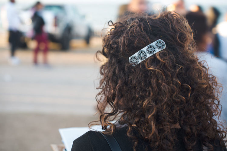 Rear View Of Woman With Curly Hair At Street