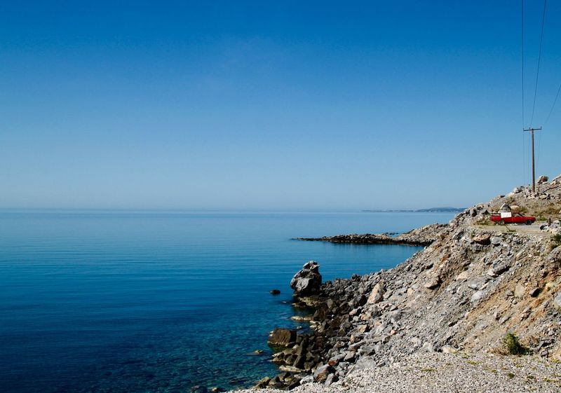 Beauty In Nature Blue Calm Car Coastline Europe Horizon Over Water Idyllic Nature No People Non-urban Scene Ocean Remote Rhodes Rippled Rock Rock - Object Rock Formation Ródos Sea Seascape Sky Vintage Cars Water The Drive