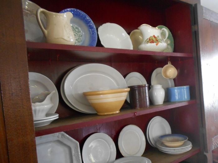 Amish Kitchen Cupboard with Ceramic Crockware Amish Home Amish Kitchen Amish Photography Country Living Crockery Dishes Millersburg, Ohio Ohio, USA Susan A. Case Sabir Unretouched Photography Amish Bowls Ceramic Crockware Dishes, Plates, Bowls, White Domestic Kitchen Indoors  Kitchen Cupboard Kitchen Life No People Plates Wooden Cabinet