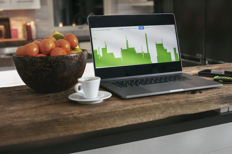 Fruits and laptop on table