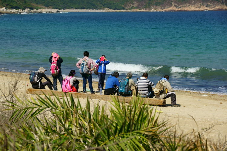 Rear View Of People At Beach