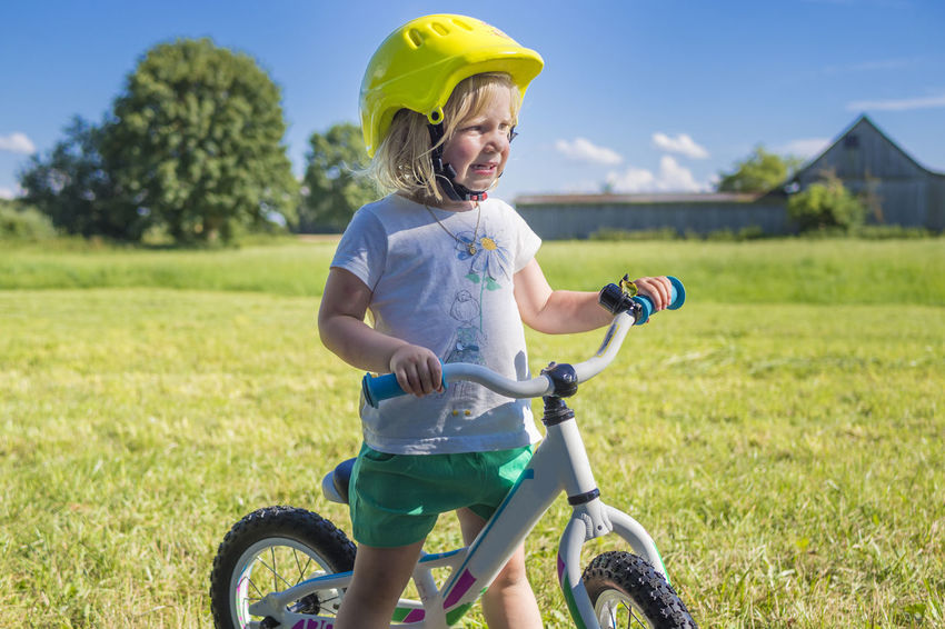 Cute little girl riding her runbike in the countryside Activity Allgaeu Allgäu Bavaria Bicycle Bike Biking Countryside Education First Girl Helmet Kindergarden Kindergarten Learn Learning Leisure Activity Lifestyles Outdoors Play Riding Runbike Safety Toddler  Traffic