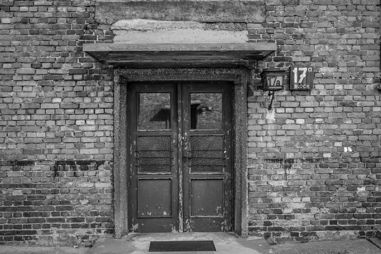 Auschwitz Auschwitz  Built Structure Architecture Door Entrance Building Exterior Closed Building Wall - Building Feature No People Day Protection Old Security Brick Wall Brick Safety Wall Outdoors Wood - Material House
