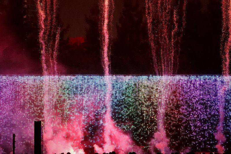 Illuminated Night Celebration Multi Colored Pixelated Tokyomidtown Roppongi Roppongi Midtown Japan Tokyo Nightphotography Nightview Nightscape Fireworks Nightshot Ledlighting Art