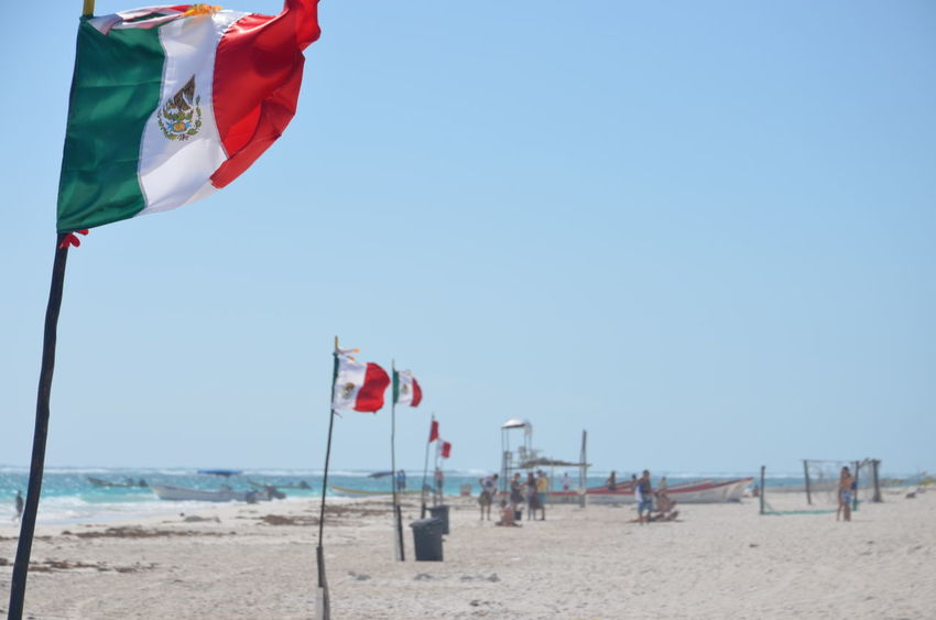 Beach Beach Umbrella Beauty In Nature Blue Coastline Day Flag Horizon Over Water Mexico Nature Outdoors Parasol Pole Red Scenics Sea Shore Sky Sunny Tourism Tranquil Scene Tranquility Travel Destinations Tulum Vacations