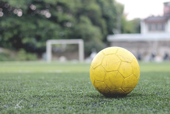 People around the world love football. Artifical Grass Ball Circle Focus On Foreground Footer Green Color Soccer Sport Yellow The Color Of Sport