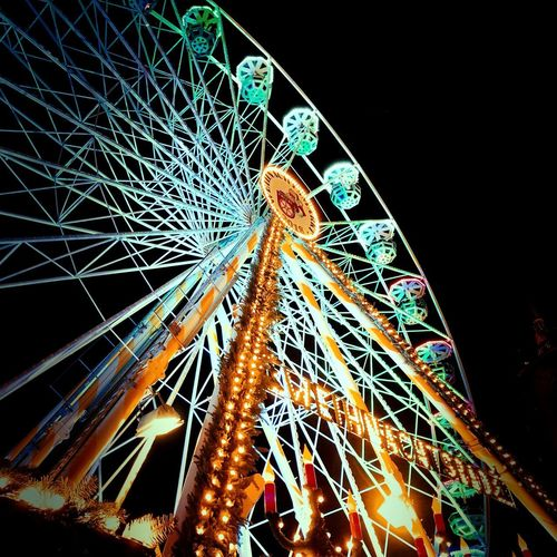 Riesenrad Illuminated Night Low Angle View Amusement Park No People Arts Culture And Entertainment Ferris Wheel Amusement Park Ride Architecture Lighting Equipment Outdoors Decoration Pattern Multi Colored Built Structure Sky Nature Glowing Celebration Light