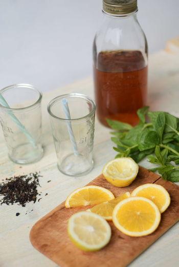 Close-up of ingredients for preparing lemon mint leaves