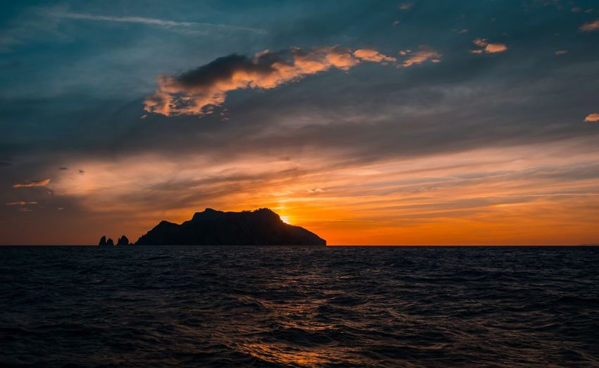 Capri Island Sea Water Sky Sunset Scenics - Nature Cloud - Sky Beauty In Nature Horizon Over Water Horizon Waterfront Orange Color Tranquility Outdoors Nature Tranquil Scene