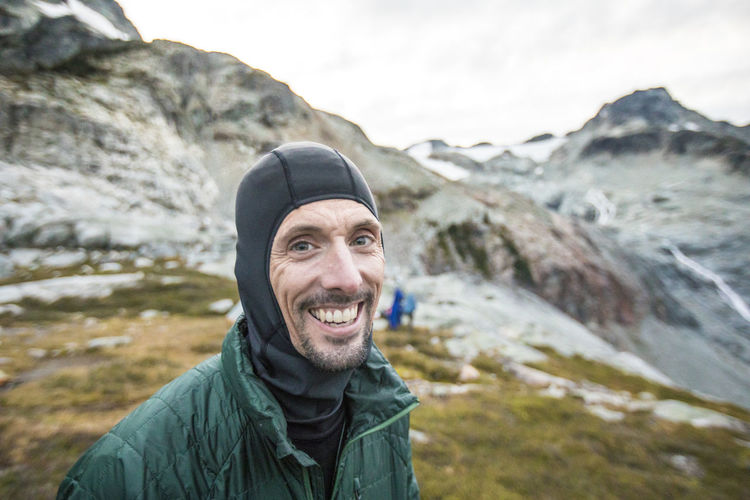 Portrait of smiling young man in mountains
