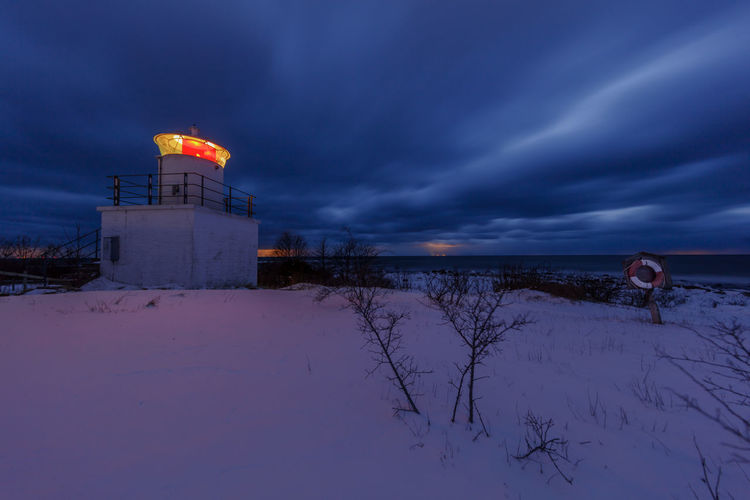 Baltic Sea Lighthouse Tokenäs Winter clouds darkness and light No People No People Outdoors Baltic Sea Lighthouse Tokenäs Winter Clouds Lifebuoy Night Sea And Sky Snow Öland