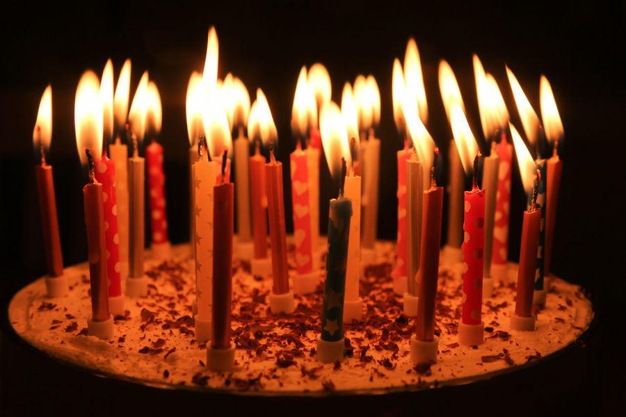 Happy Birthday Candles Burning Cake Candle Close Up Dark Dessert Event
