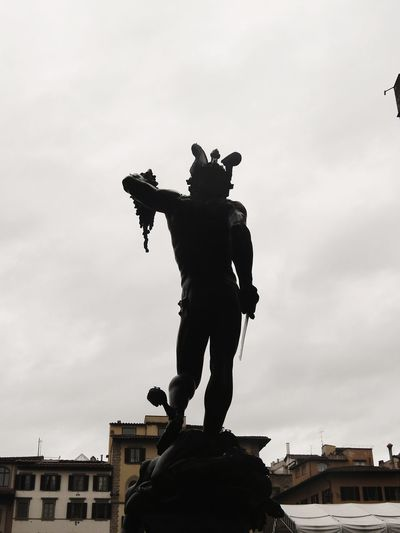 Sculpture of Perseus with the head of dei Lanzi, Florence, Italy. Street Florence Toscana Clouds And Sky Silhouette Perseus Medusa Mythology Black Full Length City Sky Statue Sculpture Street Art Male Likeness Sculpted Historic Human Representation Pedestal