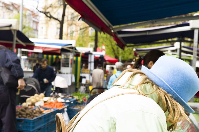 Rear view of people in market
