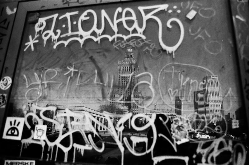 ANALOG; Rollei RPX 100 The Week on EyeEm Light And Shadow Capture The Moment Film Photography Rollei Analogue Photography Nikonphotography Street Photography Monochrome Black And White Bnw Spring Filmisnotdead Grain Text Graffiti No People Architecture Western Script Art And Craft Communication City Wall - Building Feature Creativity Built Structure Day Spray Paint Close-up Building Exterior Map Backgrounds Messy Aggression  Mural