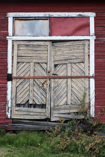 Old wooden warehouse in Hietakylä, Hamina Warehouse Wooden Warehouse Door Architecture Building Exterior Entrance Built Structure Wood - Material Day Building Closed No People Streetphotography Street Photography Plant Old Grass Safety Window Outdoors Security Shutter Past Weather Beaten