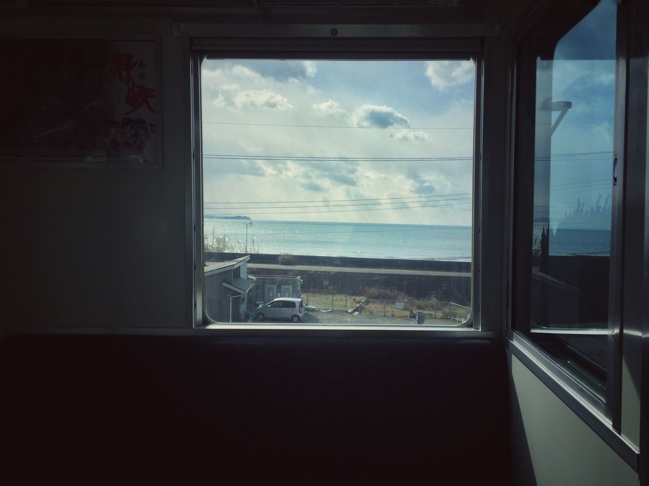 window, glass - material, transparent, sky, cloud - sky, sea, indoors, no people, water, nature, day, transportation, vehicle interior, glass, mode of transportation, horizon, sunlight, scenics - nature