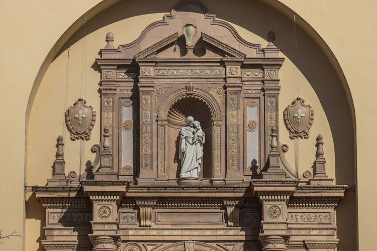 Arch Architecture Art And Craft Building Exterior Built Structure Creativity Day Female Likeness Human Representation Low Angle View Male Likeness No People Outdoors Place Of Worship Religion Sculpture Sky Spirituality Statue Travel Destinations