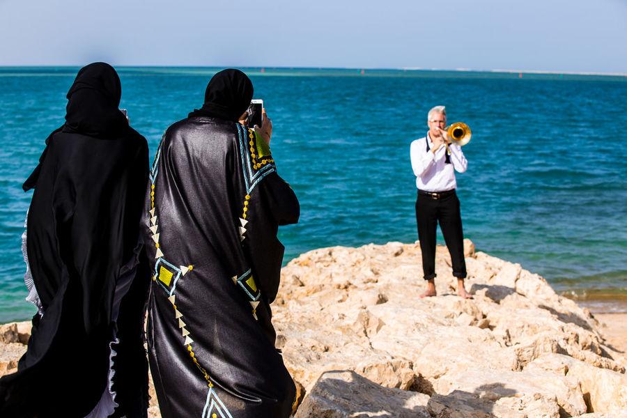 The power of music Doha Doha,Qatar Taking Photos Hello World Trombone Music Musician The Pearl 2015  Enjoying Life The Pearl, Doha Bekkerfilms Water Sea Curiosity Gentleman  World