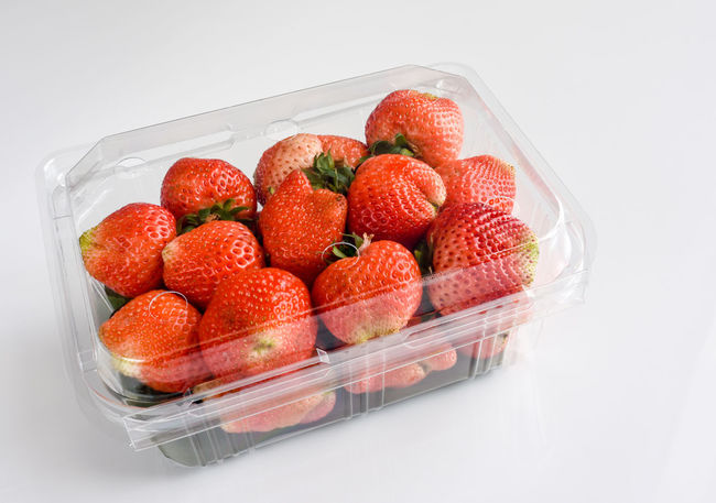 Fresh strawberry fruits in plastic box packaging, on white background. Healthy eating. Chilled PLASTIC CONTAINER Close-up Food Food And Drink Fresh Fruit Freshness Fruit Healthy Eating High Angle View Juicy Fruits Packaging PLASTIC CONTAINER Ready-to-eat Red Strawberries Refrigerated Food Refrigerated Fruit Ripe Fruit Strawberry Studio Shot Sweet Food White Background