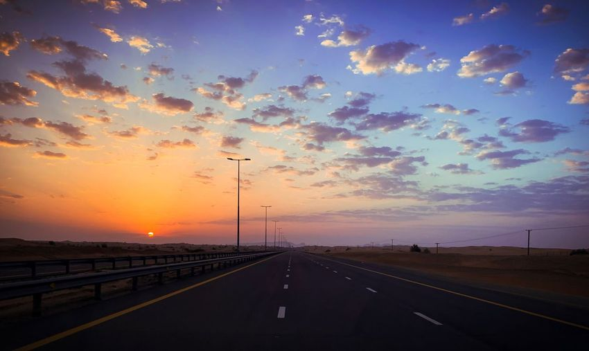 Sky Sunset Road Cloud - Sky Transportation Street The Way Forward No People Beauty In Nature Street Light Dramatic Sky Direction Highway Orange Color