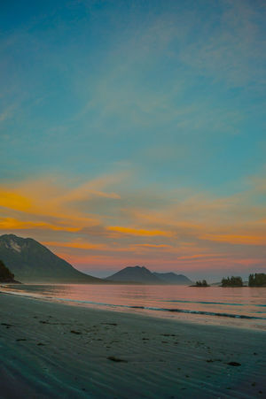 Beach Beauty In Nature Cloud - Sky Coastline Idyllic Mountain Nature Non-urban Scene Orange Color Outdoors Remote Sand Scenics Sea Shore Sky Sunset Tranquil Scene Tranquility Water The KIOMI Collection • The Great Outdoors – 2016 EyeEm Awards 43 Golden Moments