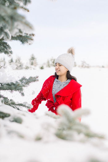 Young woman in hat during winter