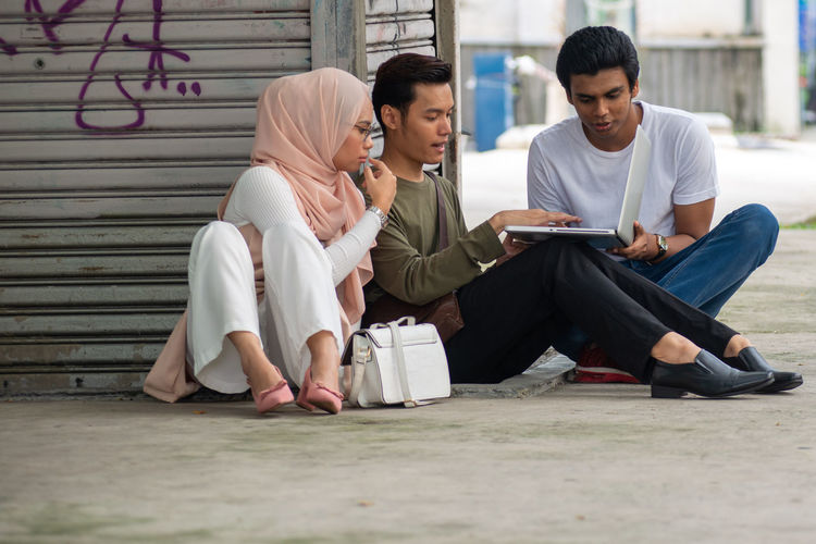 Friends sitting on mobile phone
