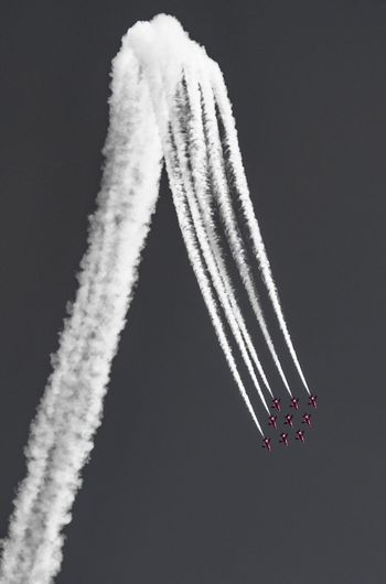 Vapor Trail Speed Airshow Flying Airplane Air Vehicle Transportation Smoke - Physical Structure Teamwork Mode Of Transport Motion Mid-air Fighter Plane Low Angle View Travel Military Airplane Sky Formation Flying Performance Arrangement Red Arrows