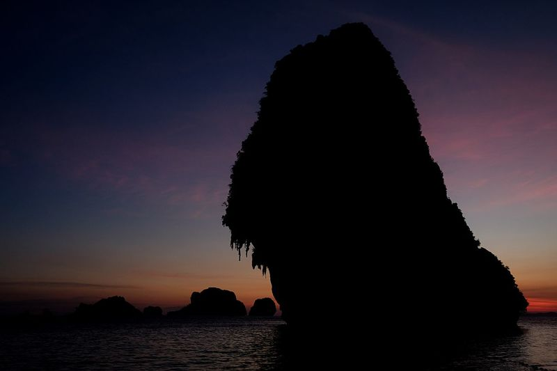 EyeEm Selects Krabi Thailand Krabi Sunset Silhouette Sea Nature Sky Beauty In Nature Scenics Rock - Object Tranquility Water Travel Destinations Outdoors No People Day Railay Beach