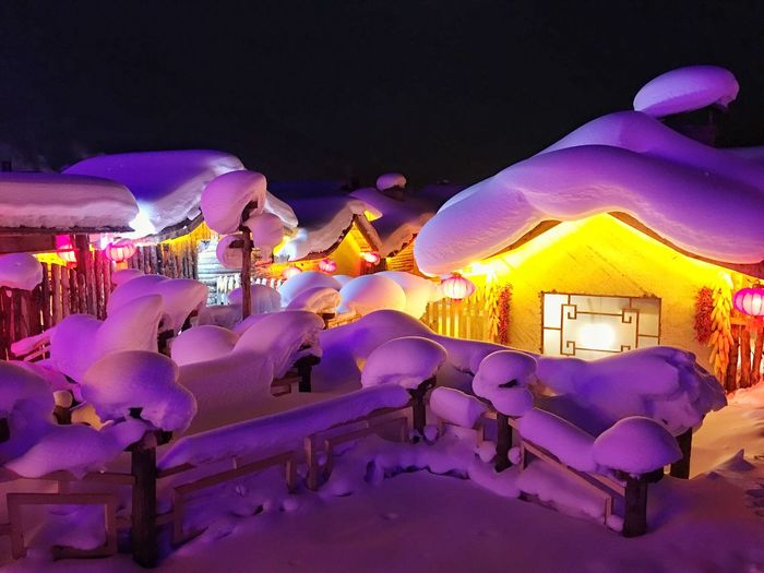 Panoramic view of people in restaurant at night during winter