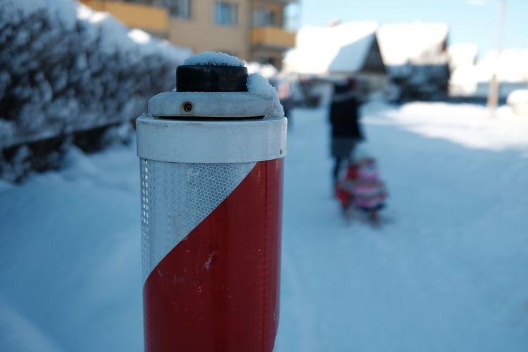 Close-up of ice cream cone in snow