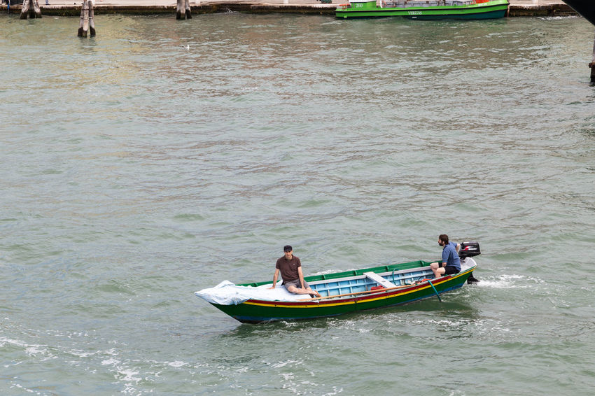Venice transport system... Venice Canals Venice Italy Venice Taxi Venice Water Taxi Venice, Italy Water Taxi Adult Boat Boats Day Italy Men Motor Boat Nature Outdoors People Real People Sea Tourist Destination Two People Venice Venice View Water Waterfront Wave