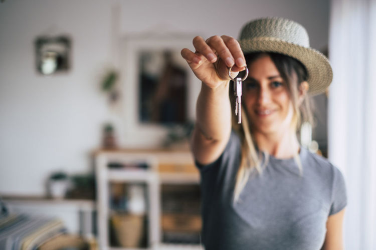 Portrait of young woman wearing hat at home