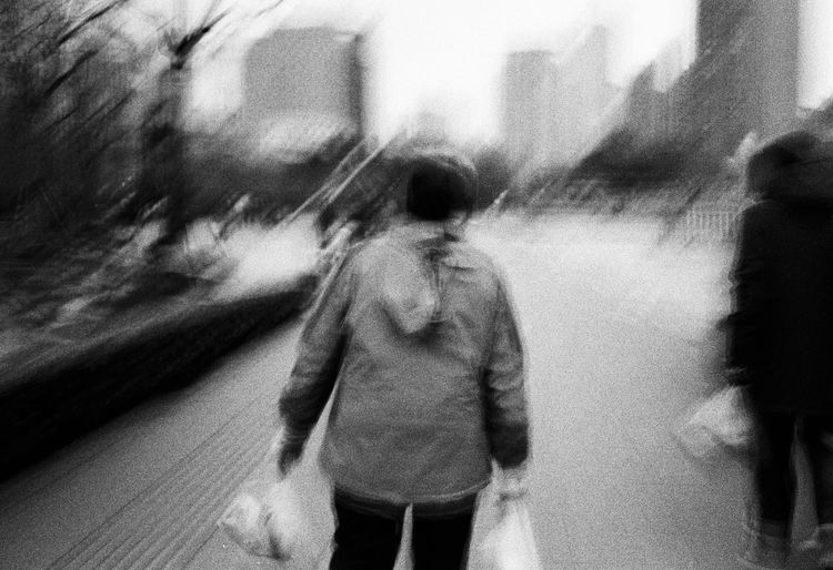 Blurred Motion Real People Walking Three Quarter Length People Rear View Motion City Casual Clothing Lifestyles Day Men Standing Street Women Transportation Architecture Adult Outdoors Leisure Activity Blackandwhite Film Photography