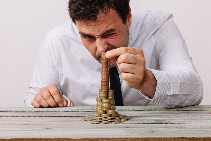 Business man stacking money to tower Budget Adult Adults Only Balance Building Business Man Cash Close-up Day Human Hand Indoors  Investing Men Money One Man Only One Person People Stacking Table Tower White Background