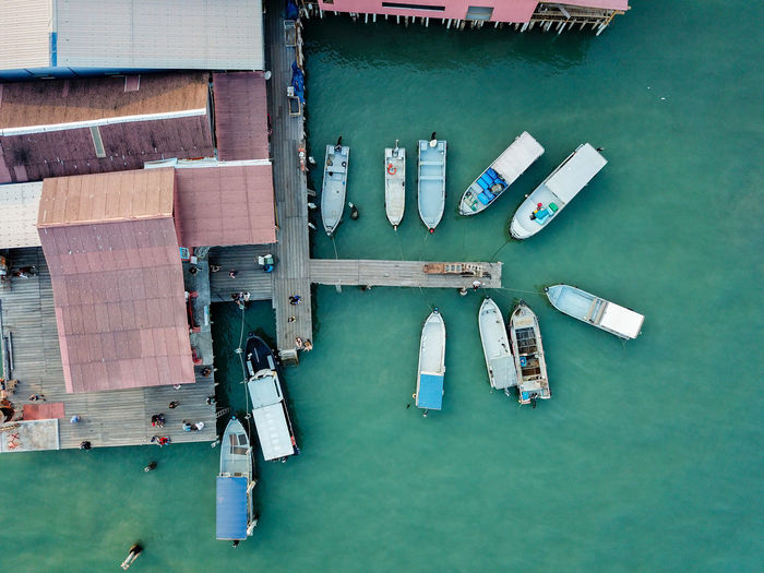 Aerial view of boats by pier in sea