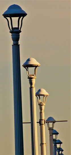 Dark and Light-s Dark And Light Lamp Post Light Pole Light Post Lights Shadows & Light Sunlight Virginia Virginia Beach Beach Close-up Day Electric Light Light Lighting Equipment Low Angle View Metal No People Outdoors Sea Shore Shadow Sky Street Light ın A Row