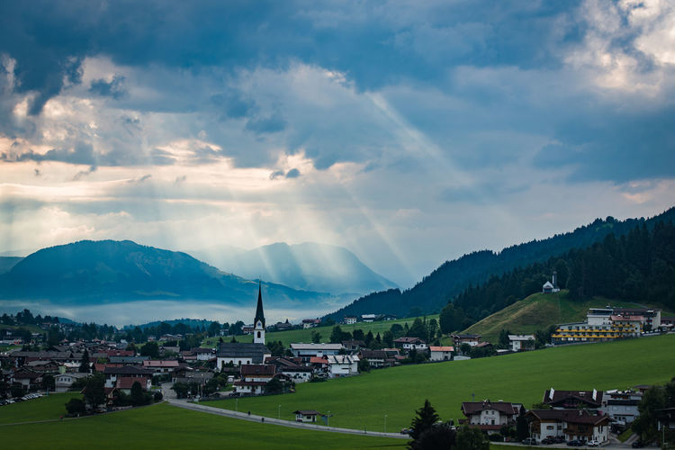 Ellmau Clouds Sun Breaking Through Clouds Ellmau Alps Cloud - Sky Sky Mountain Architecture Built Structure Building Exterior Building Beauty In Nature Scenics - Nature Nature Mountain Range City No People Environment Landscape House Day Residential District Outdoors Tranquil Scene Mountain Peak