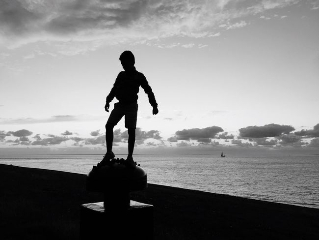 Sea Water Sky Silhouette Human Representation Beach Statue Cloud - Sky Nature Horizon Over Water Sculpture Standing Scenics Outdoors Day Men Full Length Real People Childhood Beauty In Nature Blackandwhite