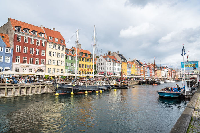 Nyhavn harbor in Copenhagen a cloudy day of summer Architecture Baltic Baltic Sea Boat Building Exterior Built Structure City Cityscape Cloud - Sky Day Harbor Harbor Landmark Mode Of Transport Moored Nautical Vessel No People Nyhavn Outdoors Scandinavia Sky Transportation Vessel Water Waterfront