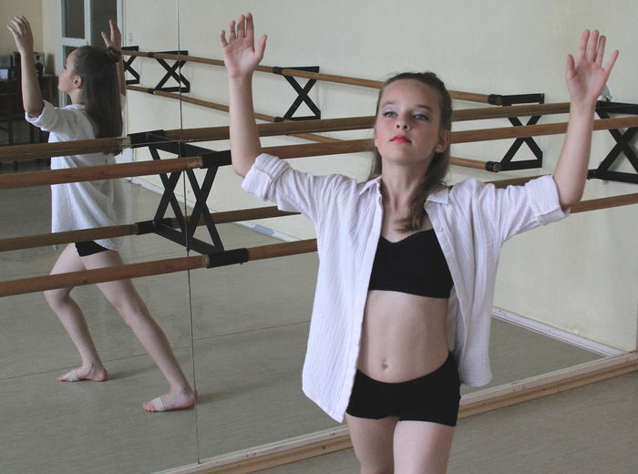 High angle view of ballerina practicing in dance studio