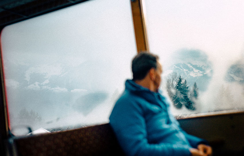 50mm VSCO Cold Temperature Day Leica Looking Through Window Nature One Person Real People Rig Sky Snow Transportation Warm Clothing Window Winter Go Higher The Traveler - 2018 EyeEm Awards