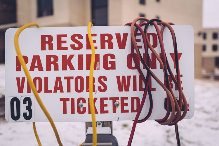 Close-up Cold Winter ❄⛄ Communication Day Extension Cords Focus On Foreground No People Outdoors Parking Spot Reserved Sign Sign Text Violators Winter Cold