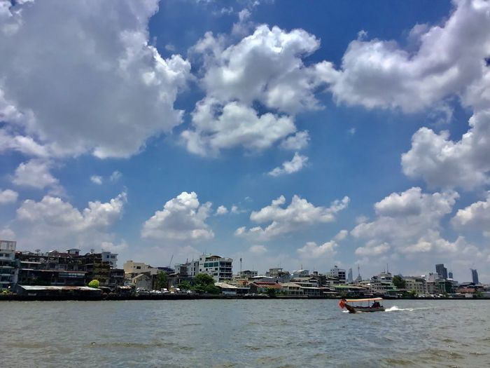 Sky Building Exterior Architecture Water Built Structure Cloud - Sky City Nature Building Day Waterfront Nautical Vessel No People Transportation River Outdoors Cityscape Passenger Craft Choapraya River Mode Of Transportation